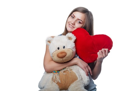 pretty: Photo of pretty woman hug cute soft toy, closeup portrait of pretty brunette female with teddy bear and red handmade heart isolated on white background, Valentine day, love and happiness concept
