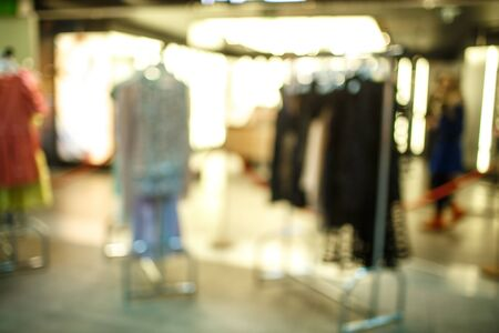 resale: Female clothes in a fashion shop. Abstract background of shopping mall, shallow depth of focus Stock Photo