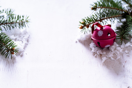 Christmas Jingle bells on a white wooden background