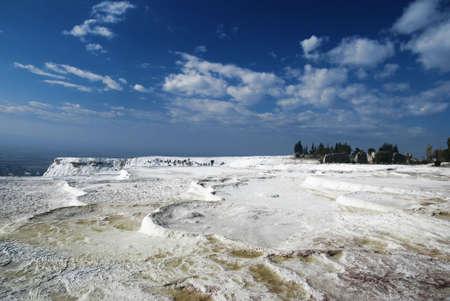 A panorama of Pamukkale salt terraces under deep blue sky photo