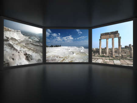 View from inside of dark room on three embrasures with photographic backgrounds of nature and ruins in them photo
