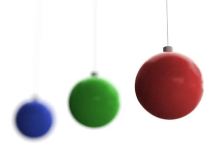 Three Christmas toys of blue, green and red color with front one in focus hanging on white background Stock Photo - 5277070