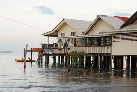 stilts: House on stilts over the sea. Old Town, Lanta island, Thailand