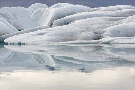mirror on the water: glacier ice and  mirror water of the lake