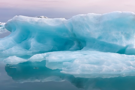 blue glacial ice in crystal clear water photo