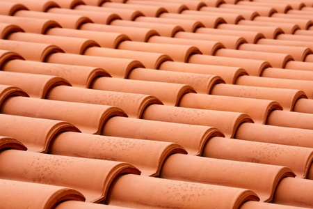 Closeup of the red clay roof tiles photo