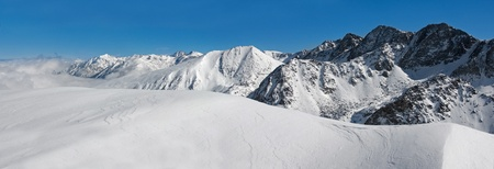 pyrenees: horizontal panorama of  winter pyrenees mountains, andorra