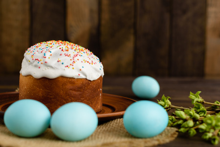 Easter cake and colorful eggs on a wooden table. It can be used as a background Stock Photo