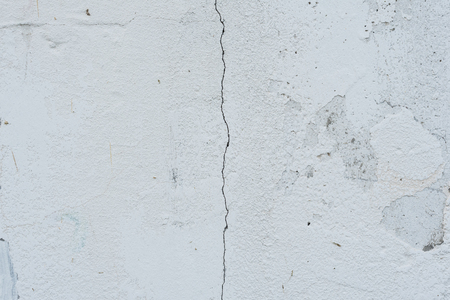 Wall fragment with scratches and cracks. It can be used as a background 스톡 콘텐츠