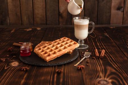 Tasty fresh Vienna wafers, green background Фото со стока