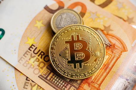 Bitcoin, Currency, digital, finance, economy. Golden bitcoin coin on Euro close up