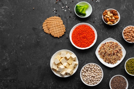 Healthy vegan food background with copy space. Nuts, beans, greens and seeds Stock Photo