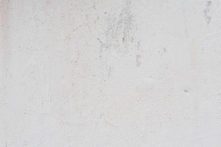 Fragmento de pared con rasguños y grietas. Foto de archivo