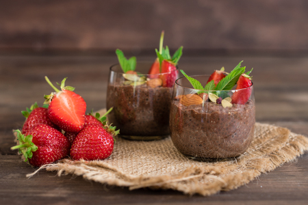 Beautiful strawberry and seeds of a chia. A fresh pudding for breakfast