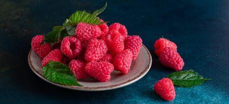 Sweet fresh organic raspberries background close-up. Fresh and sweet raspberries background