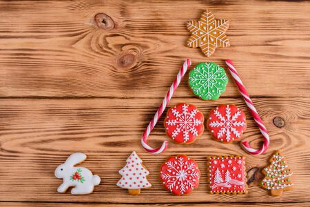 Christmas homemade gingerbread cookies on wooden table. It can be used as a background