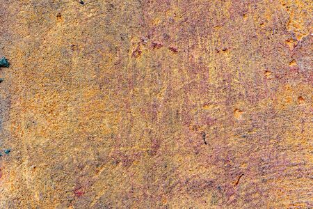 Texture of a concrete wall with cracks and scratches which can be used as a background