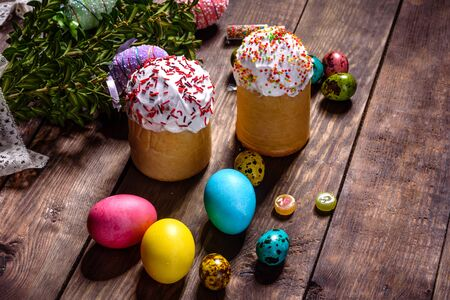 Easter cake and colorful eggs on a dark background. It can be used as a background Standard-Bild - 134855245
