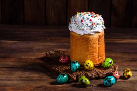 Easter cake and colorful eggs on a dark background. It can be used as a background Banco de Imagens