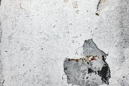 Textura de un muro de hormigón con grietas y arañazos que se pueden utilizar como fondo