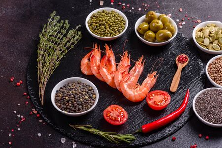 Fine selection of jumbo shrimps for dinner on stone plate. Food background Stock Photo