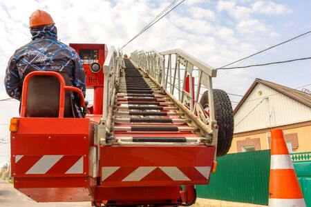 Boom of lifting wheel hydraulic crane with basket for workers for performance of high-altitude installation works