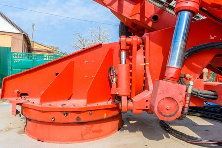 Hydraulic equipment of lifting crane with boom and basket for workers for high-altitude installation works