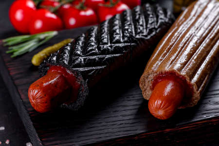 Delicious fresh hot hotdogs with various kinds of buns and sausages. Fast food, non-useful food