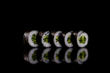 Fresh delicious beautiful sushi rolls on a dark background. Elements of Japanese cuisine