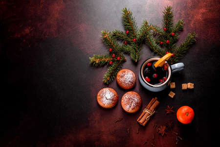 Beautiful delicious fresh cocoa muffins on the Christmas table. Preparing for the holiday