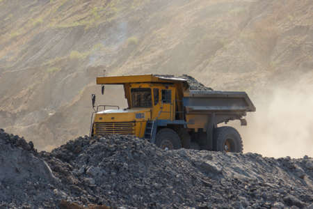 dumptruck: quarry dumptruck working in a coal mine in the transportation of rocks