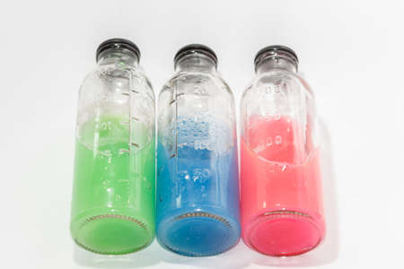 a substance vial: colored chemicals in glass bottles on a white background