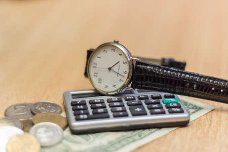 deposit slip: After working on a table clock, dollar coins. Stock Photo
