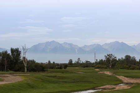 Rural landscape against mountains