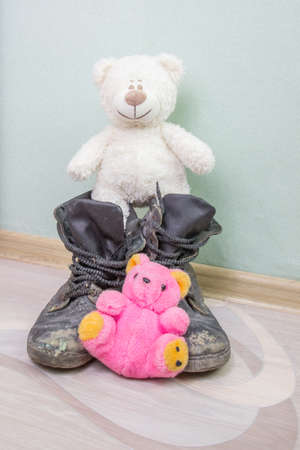 Children's toy and old army boots.