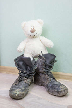 army boots: Childrens toy and old army boots.