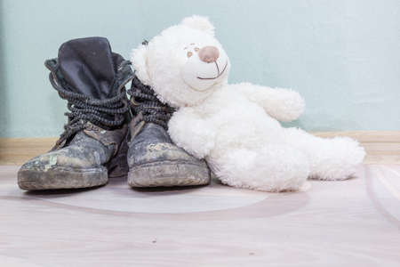 Childrens toy and old army boots.