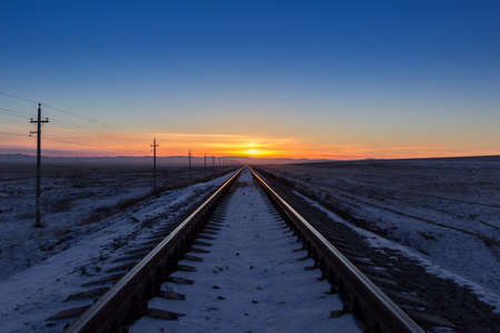 mode made: Railway receding into the distance at sunrise