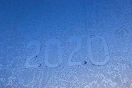 New Year 2020 inscription on frozen glass Standard-Bild