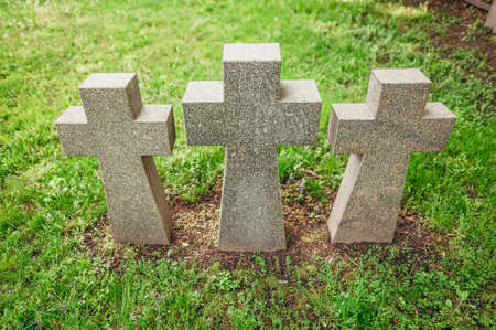 Three stone crosses in the cemetery of German prisoners of war- Wehrmacht army solders in the second world war. Kiev, Ukraine