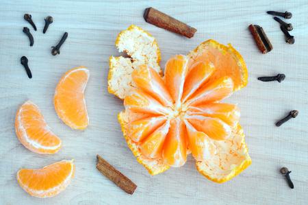 Juicy slices of mandarin on wooden background. Slice of Mandarin.