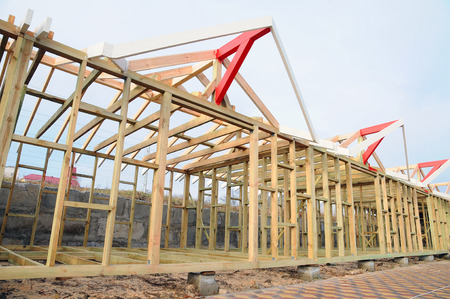 The wooden structure of the building. Wooden frame building. Wooden roof construction.