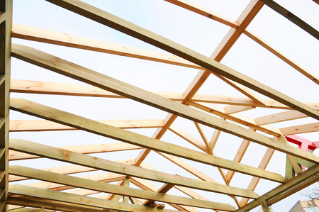 rafters: The wooden structure of the building. Wooden frame building. Wooden roof construction.
