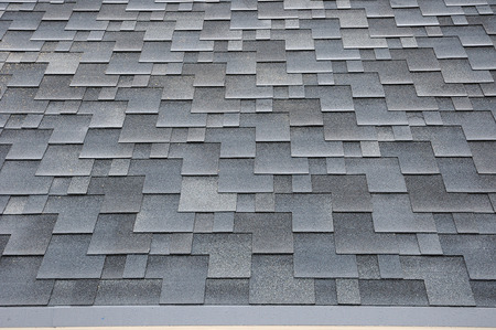 Close up view on Asphalt Roofing Shingles Background. Roof Shingles - Roofing. Bitumen tile roof. 스톡 콘텐츠
