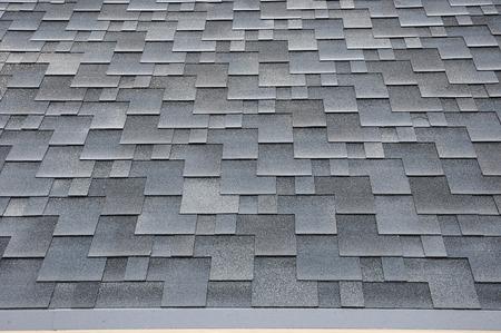 Close up view on Asphalt Roofing Shingles Background. Roof Shingles - Roofing. Bitumen tile roof. Standard-Bild