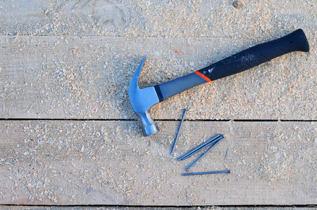hammer and nails on the wooden surface Background picture
