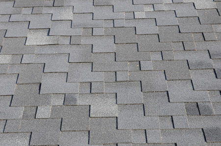 asphalt shingles: Close up view on Asphalt Roofing Shingles Background. Roof Shingles - Roofing. Bitumen tile roof. Stock Photo