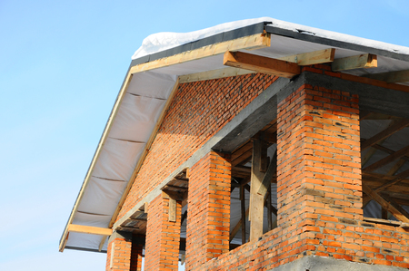 The structure of a new home and the concept of the construction. Unfinished roof. Roof construction Stock Photo
