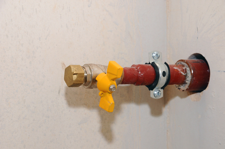 Unconnected new gas pipe with a valve.
