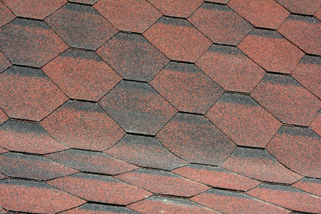 Closeup view on Asphalt Roofing Shingles Background. Roof Shingles - Roofing.